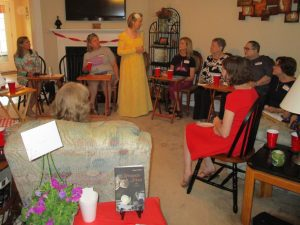Wearing my yellow Regency gown, I am seen talking with some of the Book Club ladies