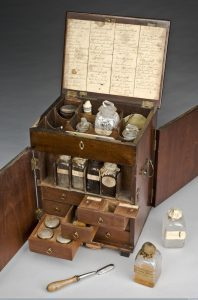 A mahogany medicine chest, England, 1801-1900 The mahogany medicine chest contains boxes, bottles and tubes of medications to treat a number of conditions. The chest includes treatments to purge the body by vomiting (emetics), by sweating (diaphoretics), as well as general purgatives such as rhubarb, jalap and calomel. Other medications include pain relief, such as opium plus astringents and stimulants, including ginger and lavender. The chest contains a handwritten inventory listing the medications. The chest also includes a set of scales, weights, a pill tile and a spatula. The set was probably used in the home or by a chemist or apothecary. (Source: Science Museum, London, and Wellcome Images CC BY 4.0)
