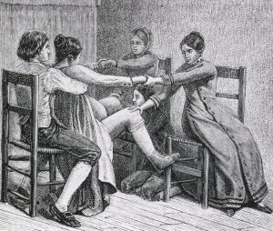 A pioneer birth scene showing a woman sitting on her husband's lap while a midwife and gossips attend her